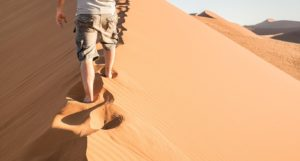 Things to know when travelling to Egypt: Safety. A man walking solo in Egyptian desert
