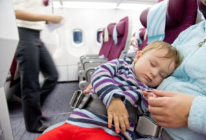 Baby sleeping during in lap flight
