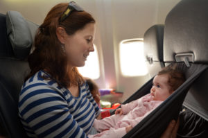 Mom Holding Baby during Flight