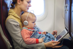 Keeping your child occupied especially during take off and landing times.