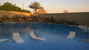 A Hotel Pool with View of the Giza Pyramids