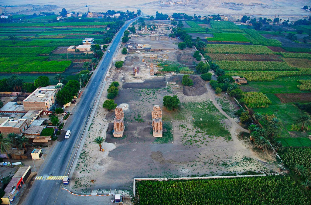 Colossi of Memnon Aerial view. These are Two massive statues of the Amenhotep III - Luxor - Egypt