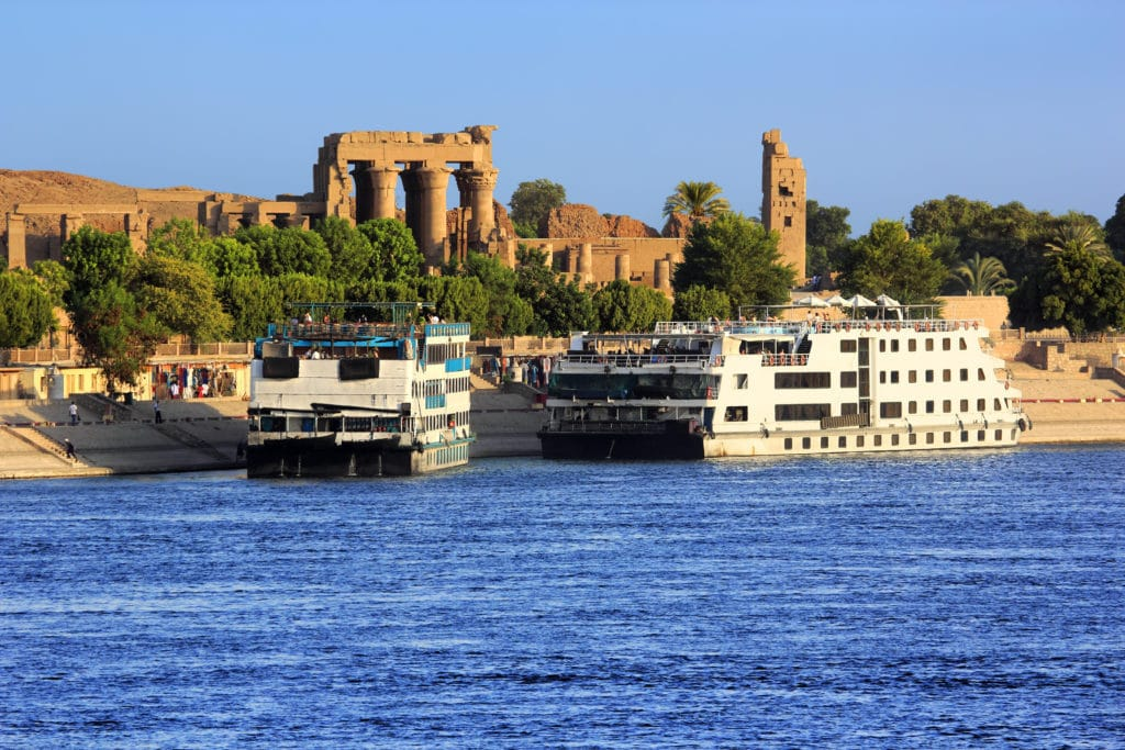 The Temple of Sobek in Kom Ombo - Aswan With Cruise ships docked  on the Nile - Egypt
